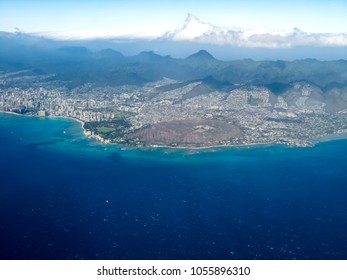 aerial view of mountains and ocean, Honolulu, Hawaii with line of clouds mimicking shape of mountain range