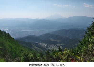 Aerial view of Mt. Fuji and South-Alpus-city, Yamanashi, Japan.