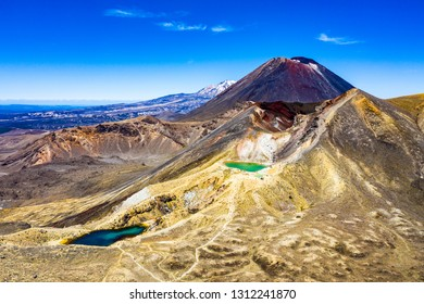 "Aerial view of Mt.Ngauruhoe (aka. Mt.Doom) and the Emerald Lakes, North Island, New Zealand on a sunny morning. Part of ""Tongariro Alpine Crossing"" the most famous NZ one day hike"