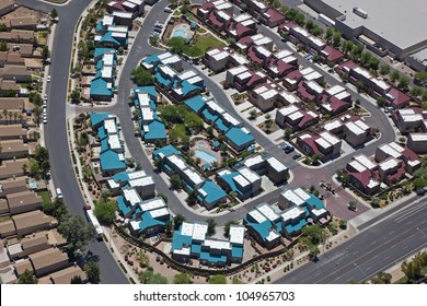 Aerial view of multicolored rooftops in a housing community