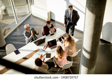 Aerial view at multiethnic group of business people working together and preparing new project on a meeting in the office