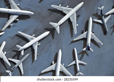 An aerial view of multiple airplanes on a runway