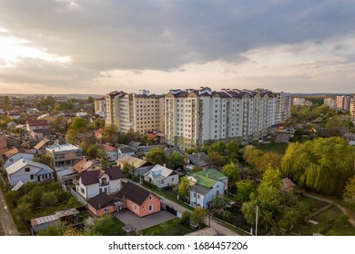 Aerial view of multistory apartment buildings in green residential area. - Shutterstock ID 1684457206
