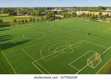 Aerial view of a multi-use playfield with soccer/lacrosse fields and a softball field with lights.