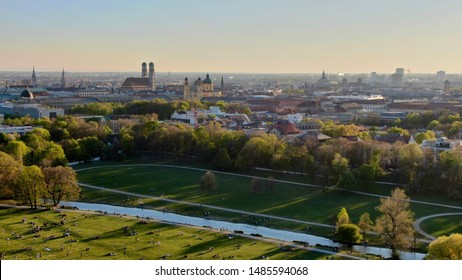 """Aerial view of the Munich cityscape with the """"Englischer Garten"""" and the """"Eisbach"""" river in front. - Shutterstock ID 1485594068"""