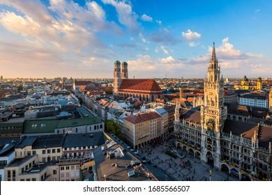 Aerial view of Munich - Marienplatz, Neues Rathaus and Frauenkirche from St. Peter's church on sunset. Munich, Germany