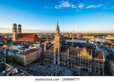 Aerial view of Munich - Marienplatz, Neues Rathaus and Frauenkirche from St. Peter's church on sunset. Munich, Germany - Shutterstock ID 1908484777