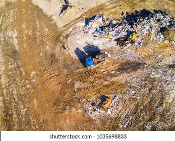 Aerial view of municipal landfill site. Typical waste treatment technology from drone view. Garbage pile in trash dump. Background texture.