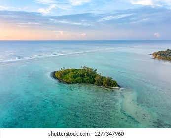 An aerial view of Muri Lagoon at sunrise on Rarotonga in the Cook Islands