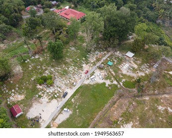 Aerial view of a Muslim cemetery compound in Malaysia. Generally the graves do not arranged systematically but the janazah's head will always face the kiblah. Selective focus points