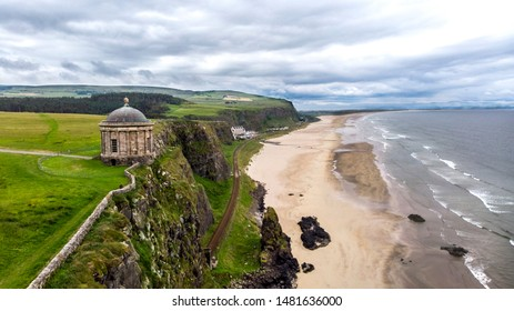 Aerial view of Mussenden Temple which  is a building located on cliffs and above the Atlantic Ocean. Castlerock, Co Derry, Northern Ireland.