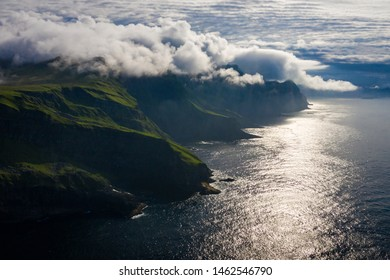 Aerial view of Mykines island in Faroe Islands, North Atlantic Ocean. Photo made by drone from above. Nordic natural landscape.