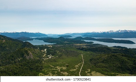 Aerial view of Nahuel Huapi Lake in San Carlos de Bariloche seen from Cerro Cathedral, Rio Negro, Argentina. Panoramic view of blue waters lake with islands and mountains surrounding.