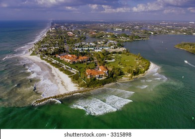 aerial view of naples florida gordon pass inlet and luxury waterfront homes