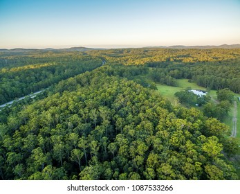 Aerial view of native Australian forests and Pacific Highway in New South Wales, Australia