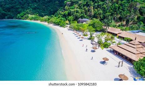 Aerial view of natural clear blue sea and white sand beach with umbrella and club house, Andaman sea, South of Myanmar, Thailand, Beautiful destination place Asia, Summer holiday vacation travel trip