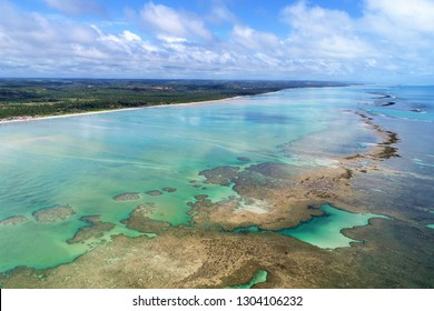 Aerial view of natural pools of Maragogi, Alagoas, Brazil. Fantastic landscape. Great colors and contrast.  Vacation on the paradise. Watch related 4K videos in https://shutr.bz/2IfbyOv