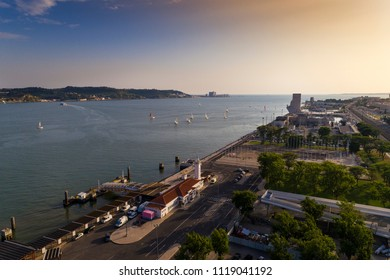 Aerial view of the Belém neighborhood in the city of Lisbon with sail boats on the Tagus River; Concept for travel in Portugal and visit Lisbon