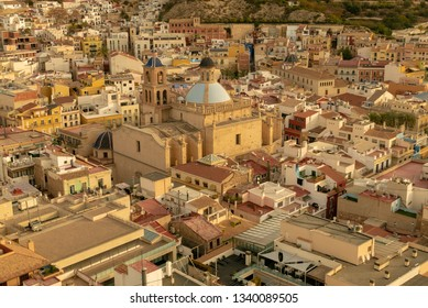aerial view of the neighborhood of Santa Cruz and the co-cathedral of San Nicolas in Alicante, Spain