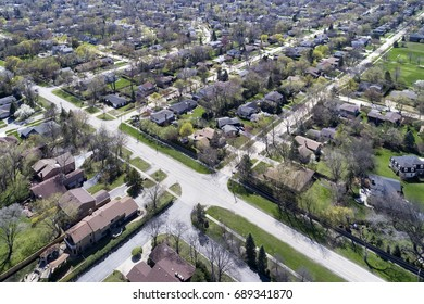 Aerial view of a neighborhood in the suburban Chicago area with homes and intersecting streets.