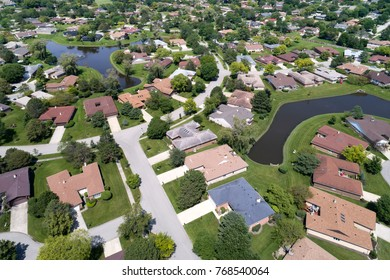 Aerial view of a neighborhood in suburban Chicago with two ponds.