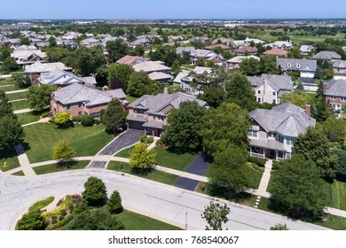 Aerial view of a neighborhood in suburban Chicago with a golf course in the distance.