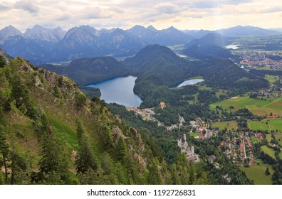 Aerial view of Neuschwanstein Castle, Alpsee Lake, Fussen and Bavarian Alps in Germany