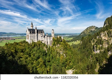 Aerial view of the Neuschwanstein Castle (New Swanstone Castle - Schloss Neuschwanstein XIX century), landmark in the Bavarian Alps, Germany. One of the most visited castles in Europe
