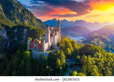 Aerial view of Neuschwanstein Castle with scenic mountain landscape near Fussen, Bavaria, Germany. Neuschwanstein castle at sunset, Germany. Neuschwanstein castle one of the most popular palace.