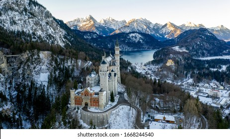 Aerial view of Neuschwanstein Castle at sunrise in winter landscape. Bavaria, Germany