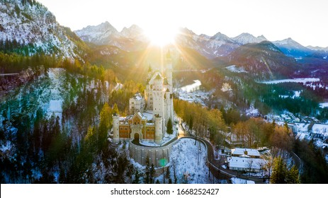 Aerial view of Neuschwanstein Castle at sunset in winter landscape. Bavaria, Germany