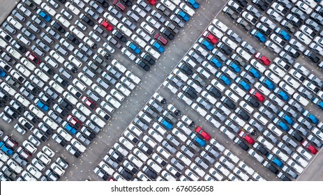 Aerial view new car lined up in the port for import and export business logistic to dealership for sale, Automobile and automotive car parking lot for commercial business  industry.