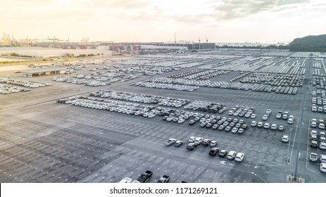Aerial view new cars lined up at distribution centre. Cars distribution centre for import and export.