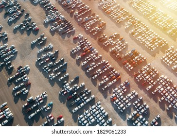 Aerial view new cars parking for sale stock lot row, New cars dealer inventory import export business commercial global, Automobile and automotive industry distribution logistic transport worldwide. - Shutterstock ID 1829061233