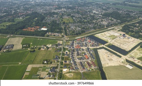 Aerial view of a new district in Heerhugowaard, Netherlands with a lot of colorful houses. In the back of the picture a district built in the seventies.