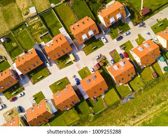 Aerial view of new family houses. Construction industry in the city from above. Residential area from drone view. Background texture concept.