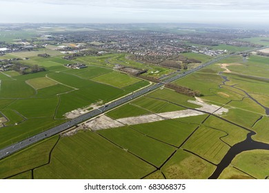 Aerial view of the new freeway exit at highway A9 at Heiloo, Holland. The beginning of the groundwork has been done. On the clear horizon the Noordzee.