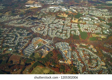 Aerial view of new homes in developments showing cul de sacs and roads