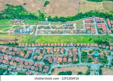 Aerial view of new housing subdivisions in the Philippines, as population growth forces urban expansion into agricultural land near Manila on Luzon island.