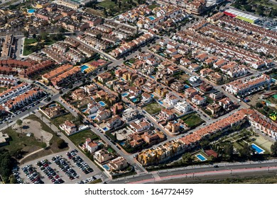 Aerial view of new residential area in Torre del Mar in Andalusia, Spain. Colourful houses in white, red and yellow on a sunny day.