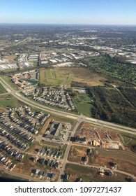 An aerial view of a new suburban subdivision development, being built on former farm land