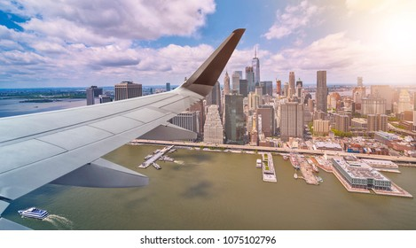 aerial view of New York City, Manhattan, from an airplane with wing in front, travel concept
