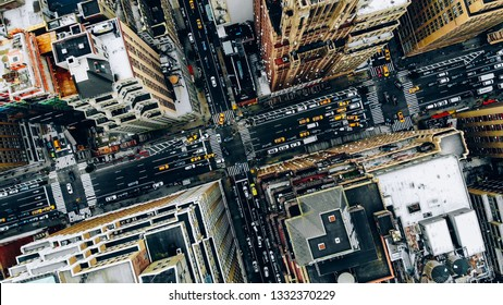 Aerial view of New York downtown building roofs. Bird's eye view from helicopter of cityscape metropolis infrastructure, traffic cars, yellow cabs moving on city streets and crossing district avenues - Shutterstock ID 1332370229