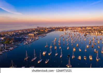 Aerial view of Newport Beach harbor in Orange County, California early in the morning with boats below.
