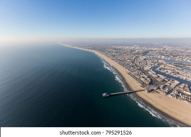 Aerial view of Newport Beach pier with pacific coast fog in Orange County, California.