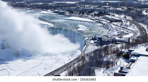 Aerial view of Niagara Falls' Horseshoe Falls. Image shows the curve of the falls as well as some of the land around this well known natural Wonder of the World.