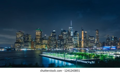 Aerial view and night panoramic of the skyline and the illuminations of Manhattan, in New York, from a viewpoint in New Jersey