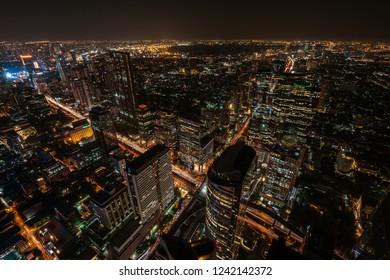 Aerial view of night scene of Bangkok skyline.
