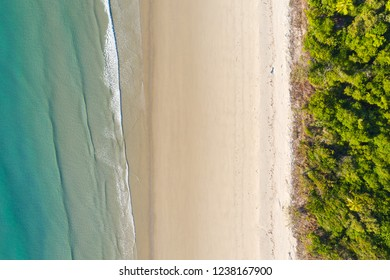 An aerial view of Noah Beach Daintree region in afr north Queensland. Angled directly down. This stretch of coast the rain forest grows right down to the coast.