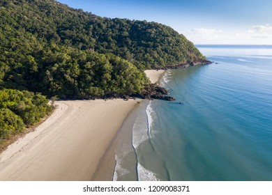 Aerial view of Noah Beach located on the Daintree coast north of Cairns. The rainforest meets the ocean in this pristine section of coastland in Queensland Australia.